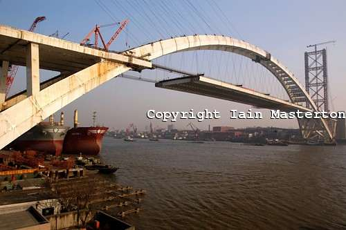 Lupu Bridge,Shanghai,China,world's longest arch bridge,Shanghai Science Commission and Engineering Administration,precise jointing,huangpu river,pudong,lupu bridge sightseeing